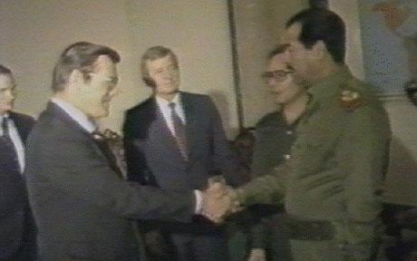 Donald Rumsfeld and Saddam Hussein celebrate U.S. support of his regime.